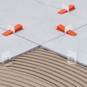 Tile leveling clips and wedges